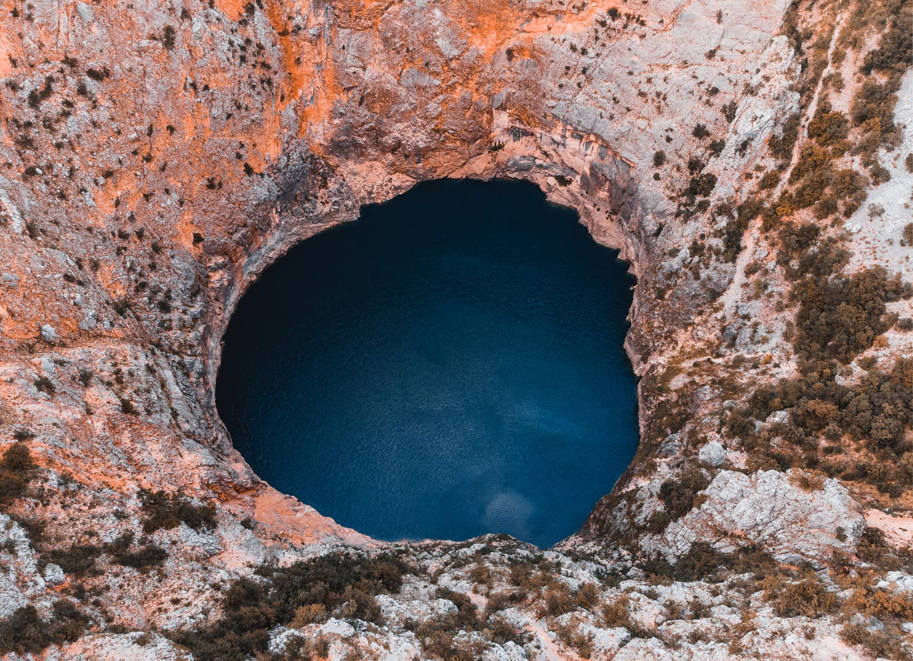 close up photography of hole and body of water