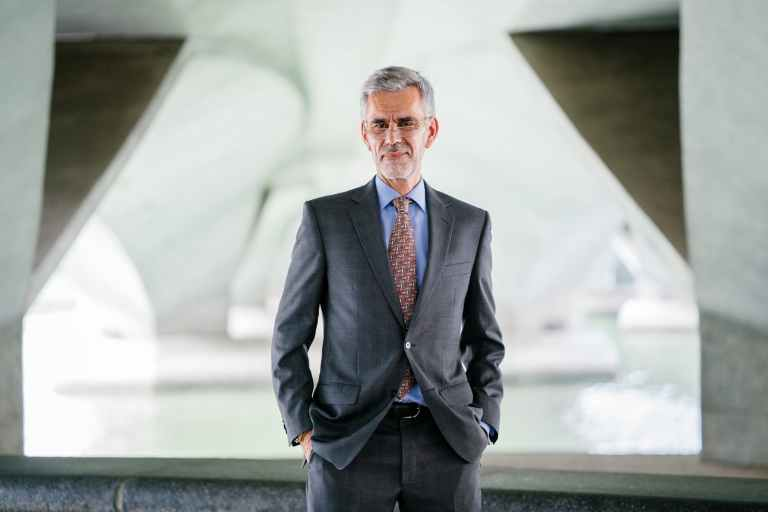 selective focus photograph of man wearing gray suit jacket